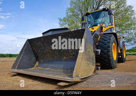 Gelbe Bulldozer auf einer Baustelle - Stockfoto
