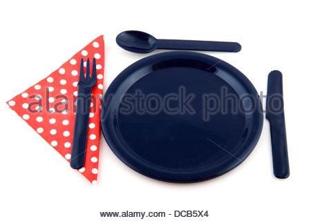 Blaue Platte mit gepunkteten Serviette - Stockfoto