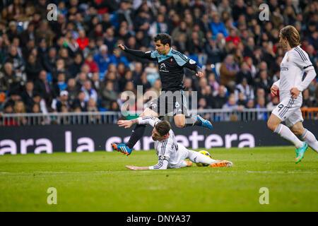 Madrid, Madrid, Spanien. 6. Januar 2014. Alex Lopez springen über Sergio Ramos mit Modric (R) bei einem Liga-Spiel - Stockfoto