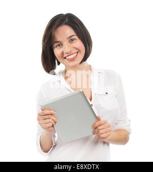 Junge lächelnde Frau mit einem elektronischen Tablet, isoliert auf weiss - Stockfoto