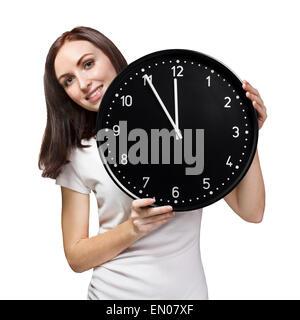Frau hält eine Büro-Uhr - Stockfoto