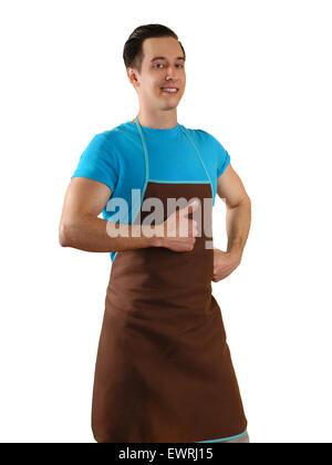 junger Mann in eine Schürze mit erhobenen Daumen zeigen - Stockfoto