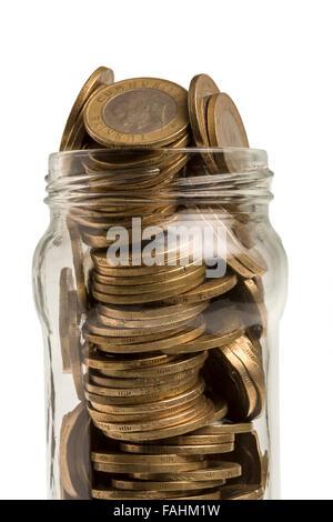 Glas mit türkischen Münzen in isoliert auf weißem Hintergrund - Stockfoto