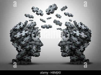 Lösung Austausch und Transfer von Ideen Konzept als eine Gruppe von Jigsaw Puzzle-Teile geformt wie zwei menschliche - Stockfoto