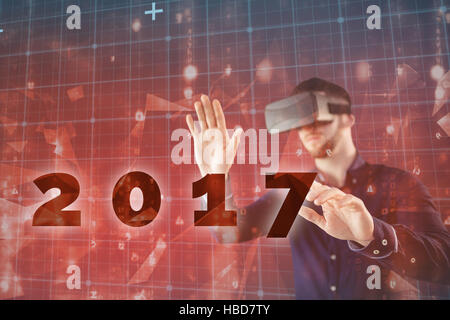 Zusammengesetztes Bild des Mannes mit virtual-Reality-simulator - Stockfoto