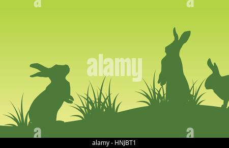 Auf grünem Hintergrund Landschaft Ostern Hase Silhouetten - Stockfoto
