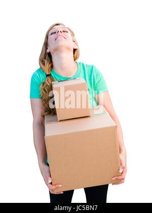 Müde junge Frau hält, Umzugskartons, Isolated On White Background. - Stockfoto
