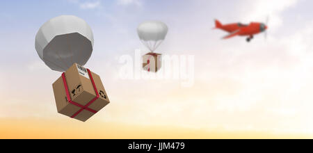 Zusammengesetztes Bild Grafik 3d Fallschirm mit Karton - Stockfoto