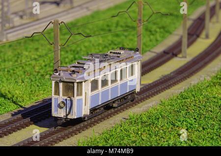 Elektrische Straßenbahn in Miniatur. Eisenbahn Transport - Stockfoto