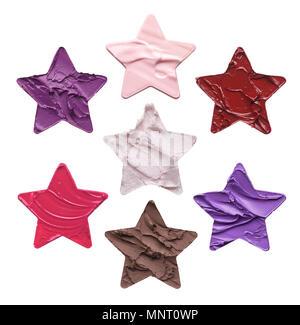 Schablonensatz in Form von fünfzackigen Sternen auf weißem Hintergrund. Textur einer Lippenstift oder Gesicht Creme ist in der Form eines von fünf gemacht - Stockfoto