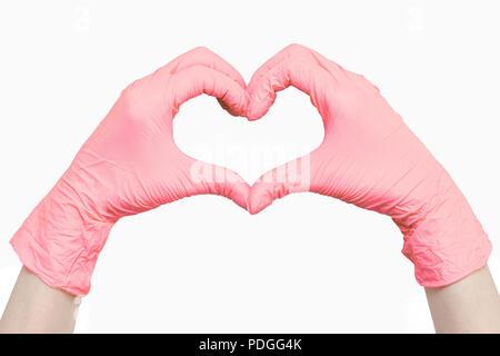 Herz aus rosa Medizinische Handschuhe auf weißem Hintergrund - Stockfoto