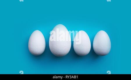 Weißer Schaum Eier auf blauem Hintergrund. Flach, Ansicht von oben. Ostern Konzept. - Stockfoto
