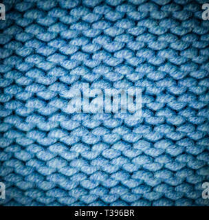 Blauen Stoff Kammgarn Textur mit Vignette. Hintergrund, Handwerkskunst. - Stockfoto
