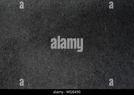Von glatten Stein schwarz Straße Asphalt Textur Hintergrund geschlossen - Stockfoto