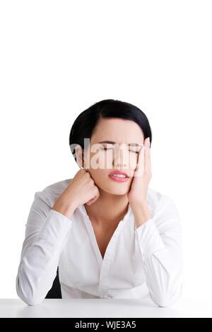 Geschäftsfrau mit großen Problem, Kopfschmerzen oder Depressionen - Stockfoto
