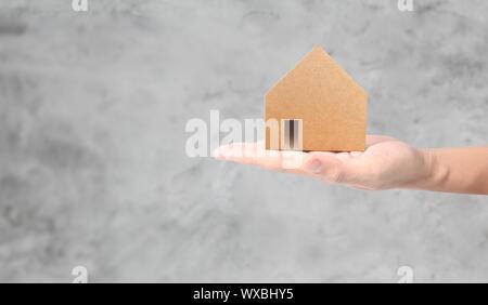 Haus Wohn- Struktur in der Hand, business Home Idee - Stockfoto