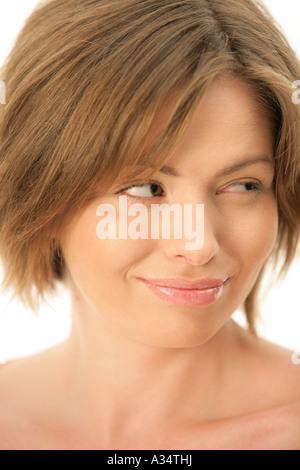 Junge Frau, die skeptisch - Stockfoto