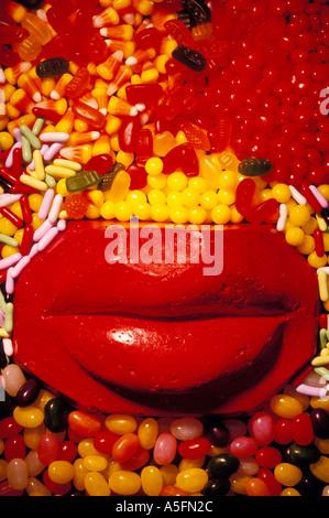 Rote Lippen und Süßigkeiten - Stockfoto