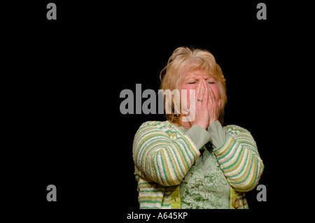 Eine Frau verärgert und Weinen. Bild von Jim Holden. - Stockfoto