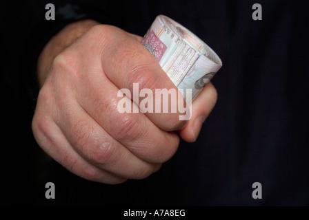 Eine Faust voller Geld - Stockfoto