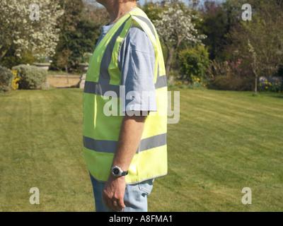 Mann mit Sicherheit Weste Seitenansicht - Stockfoto