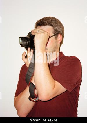 Ein Mann mit dem Fotografieren - Stockfoto