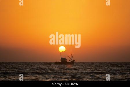 Sunset Colva Beach Goa Indien - Stockfoto