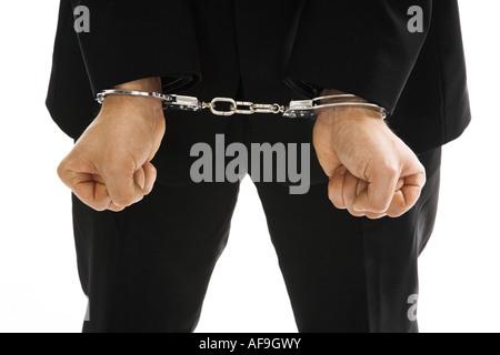 Mann mit Handschellen, close-up - Stockfoto