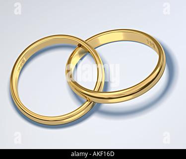 zwei Ringe aus gold Interlock Symbol der Hochzeit Ehebeziehung Verbindung fusion - Stockfoto