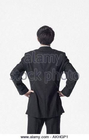 Rückansicht eines Kaufmanns - Stockfoto