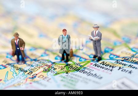 Drei Unternehmer Zahlen stehen auf Karte von Ostküste - Stockfoto