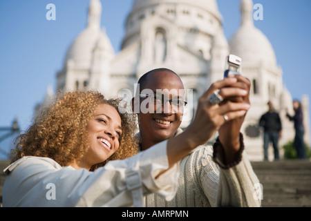 African paar nehmen eigene Foto - Stockfoto