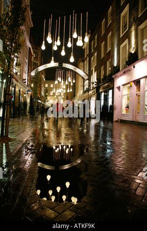 Weihnachtsbeleuchtung auf der Carnaby Street, Soho, London - Stockfoto