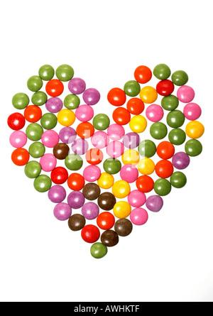 Zucker bedeckte Pralinen in Herzform - Stockfoto