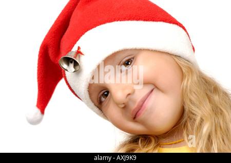 Lächelnde Mädchen in Weihnachtsmütze - Stockfoto