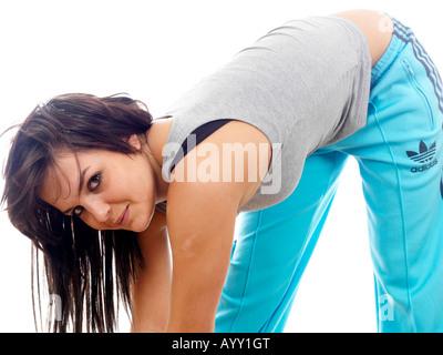 Teenager Stretching Beine Modell veröffentlicht - Stockfoto