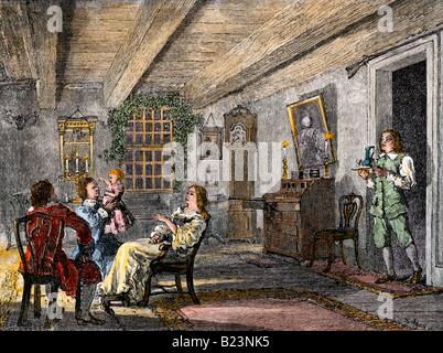 Holländische Familie zu Hause in Colonial New York 1700. Hand - farbige Holzschnitt - Stockfoto