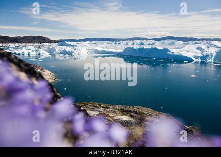Schnell schmelzende Eisberge im UNESCO-Weltnaturerbe Ilulissat Ice Fjord in Grönland - Stockfoto