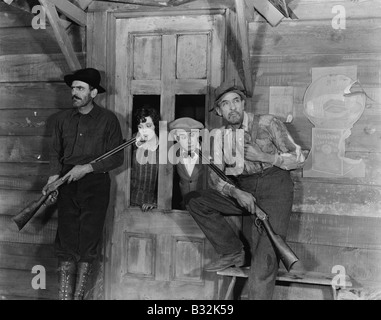 Bewaffnete Männer Paar als Geisel - Stockfoto