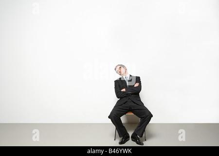 Geschäftsmann, schlafen im Stuhl - Stockfoto