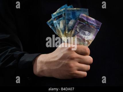 Hand voll Geld - Stockfoto