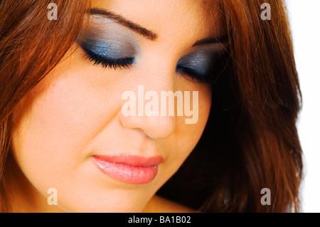 Schöne Frau mit blauen Lidschatten - Stockfoto