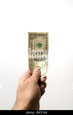 Hand, die ein-Dollar-Banknote vor einem weißen Hintergrund - Stockfoto