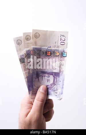 Hand, die britische Geld vor einem weißen Hintergrund - Stockfoto