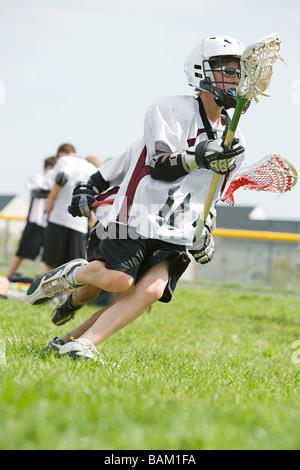 Junior Lacrosse-Spieler - Stockfoto