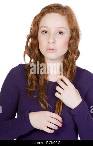 Isolierte Schuss von einem hübschen roten geleitet Teenager - Stockfoto