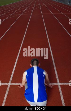 Heckansicht des Athleten am start - Stockfoto