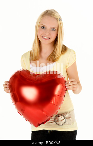 Teenager-Mädchen mit herzförmigen Ballon - Stockfoto