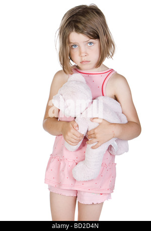 Eine traurige Blonde Kind halten erschossen Sie ihr Teddy Bär - Stockfoto