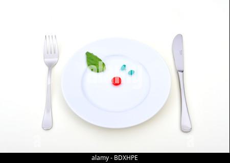 Symbolisches Bild für synthetische Nahrungsmittel, Pille Verbrauch, Drogenmissbrauch, DietSymbolic Bild für synthetische - Stockfoto